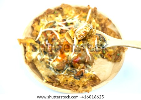 Oysters fried in egg batter on white background  - stock photo