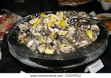 Oysters in citrus sauce - stock photo