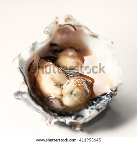 Oysters in spicy sauce Trinidad and Tobago local food - stock photo
