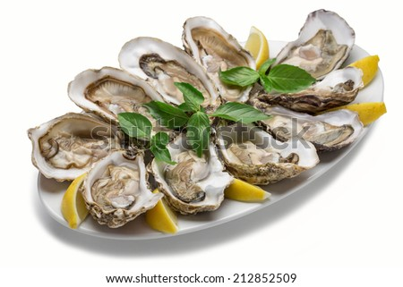 Oysters with lemon on the plate isolated on white background - stock photo
