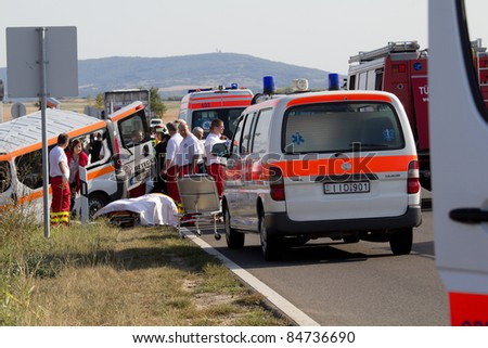 PÉCS, HUNGARY - SEP 15: Firefighters help the victim of car accident on Sept.15, 2011 on Road 6 in Pécs, Hungary. - stock photo