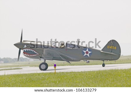 P-40E WarHawk fighter plane at Mid-Atlantic Air Museum World War II Weekend and Reenactment in Reading, PA held June 18, 2008 - stock photo