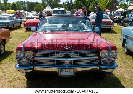 """PAAREN IM GLIEN, GERMANY - MAY 26: Cars Cadillac deVille Convertible, """"The oldtimer show"""" in MAFZ, May 26, 2012 in Paaren im Glien, Germany - stock photo"""
