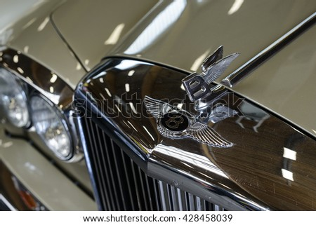 "PAAREN IM GLIEN, GERMANY - MAY 15: Close up of a Bentley logo on a retro car Bentley R Type, ""The oldtimer show"" in MAFZ, May 15, 2016 in Paaren im Glien, Germany - stock photo"