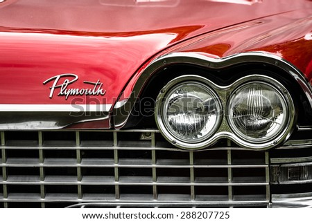 PAAREN IM GLIEN, GERMANY - MAY 23, 2015: Fragment of a full-size car Plymouth Belvedere (Third generation). Front view. The oldtimer show in MAFZ. - stock photo