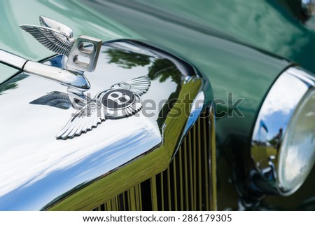 PAAREN IM GLIEN, GERMANY - MAY 23, 2015: Hood decoration of a full-size luxury car Bentley S1. The oldtimer show in MAFZ. - stock photo