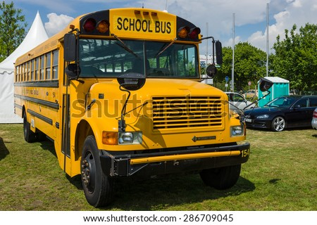 "PAAREN IM GLIEN, GERMANY - MAY 23, 2015: School Bus International Harvester 3800 ""Schoolmaster"". The oldtimer show in MAFZ. - stock photo"