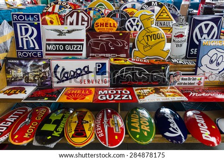 PAAREN IM GLIEN, GERMANY - MAY 23, 2015: The background of the emblems of various auto and moto brands. The oldtimer show in MAFZ.