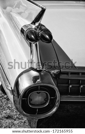 PAAREN IM GLIEN, GERMANY - MAY 19: The rear brake lights Full-size luxury car Cadillac Sixty Special Fleetwood, black and white, The oldtimer show in MAFZ, May 19, 2013 in Paaren im Glien, Germany - stock photo