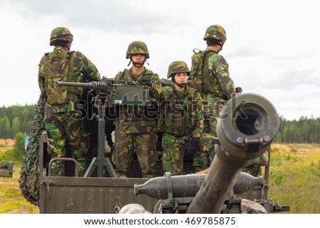 "PABRADE / LITHUANIA - AUGUST 7, 2016: Portuguese soldiers stands on a military truck with a field howitzer on multinational exercise ""flaming thunder"" in pabrade / lithuania at august 7 ,2016"