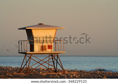 Pacific Coast line with a lifeguard station in California, USA - stock photo