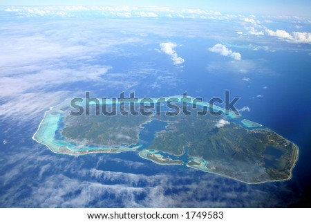 Pacific Island hidden by the clouds, Huahine , French Polynesia - stock photo