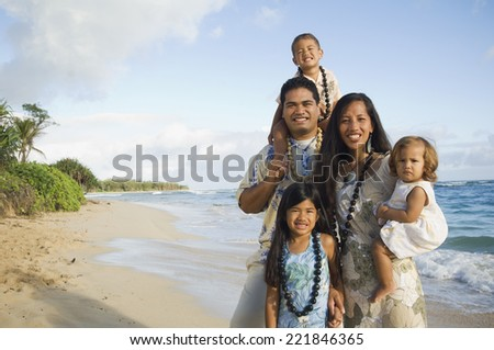 Pacific Islander family at beach - stock photo