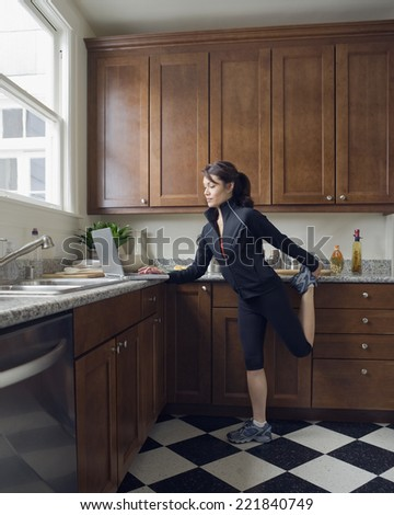 Pacific Islander woman stretching - stock photo