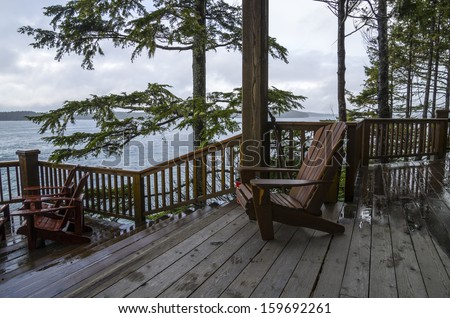 Pacific Ocean view and Adirondack Chairs in Tofino, British Columbia, Canada - stock photo