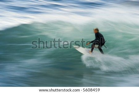 Pacific Surfer in slow motion - stock photo