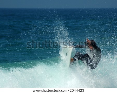 Pacific Surfer in the Spray - stock photo