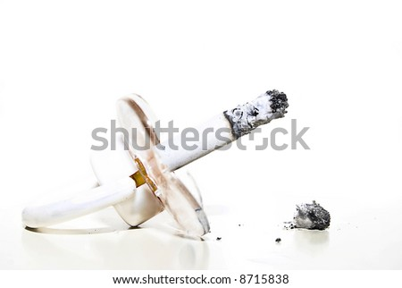 pacifier and tobacco isolated on white - stock photo