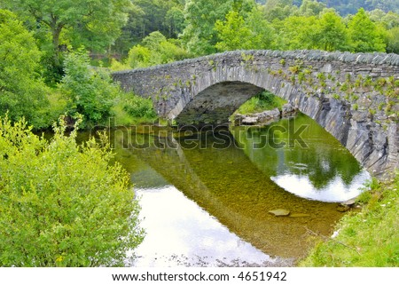 Pack-horse bridge over the river Derwent at Grange in Borrowdale, near Keswick in the English Lake District - stock photo