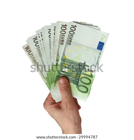 Pack of banknotes of denomination 100 euro in a hand of the man (isolated from background)