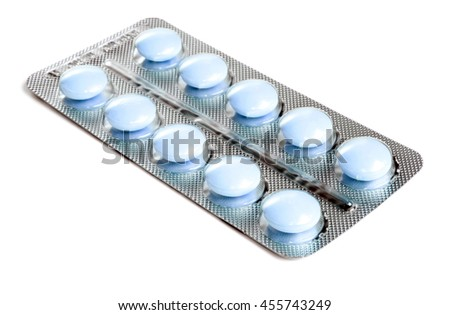 Pack of blue tablets isolated on white background. - stock photo