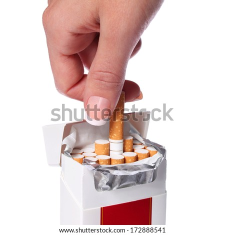 Pack of Cigarettes and Female Hand isolated on white background - stock photo
