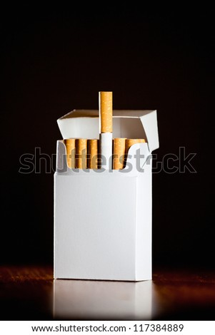 Pack of cigarettes isolated on black background,small depth of field - stock photo