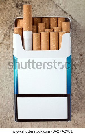 Pack of cigarettes with cigarettes sticking out. Copy space for your text. - stock photo