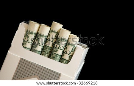 Pack of cigarettes with dollar bills - stock photo