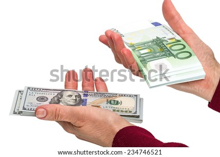 Pack of 100 dollars and euro banknotes in the hands of women. Isolated on white background - stock photo