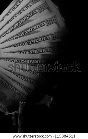 pack of dollars burned on black background - stock photo