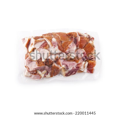 pack of raw chopped bacon on a white background - stock photo