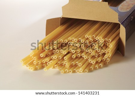 Pack of spaghetti on white background