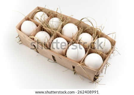 pack of ten white eggs isolated on white background  - stock photo