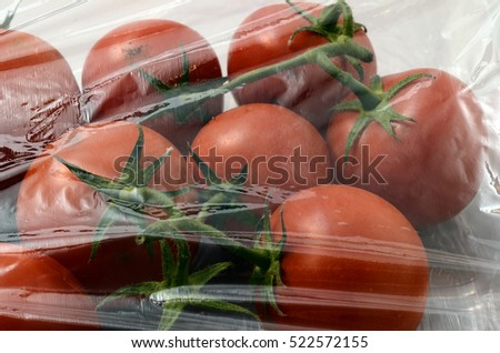 Pack of tomatoes under plastic film