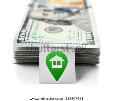 Pack with many hundred dollars for house purchase, isolated on white - stock photo