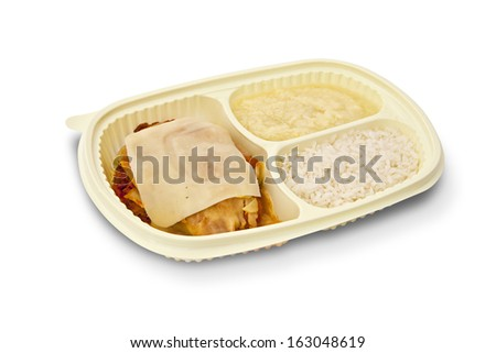 Package for freezing food or to go of parmesan chicken fillet, rice and mashed potatoes on white background. - stock photo