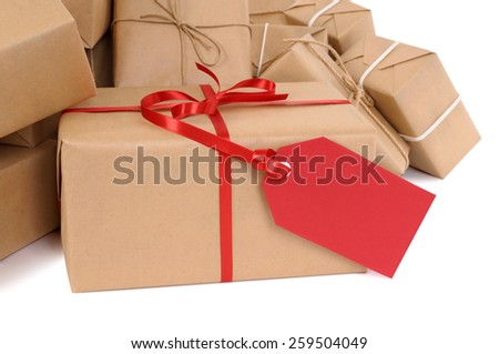 Package, gift : heap of brown parcel, red tag isolated - stock photo