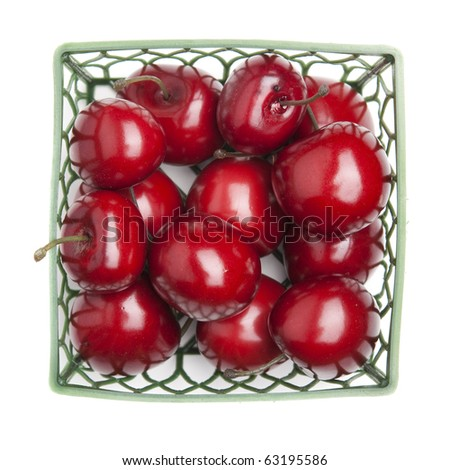 package of cherries isolated on white.