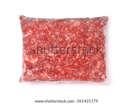 Package of frozen meat isolated on white - stock photo