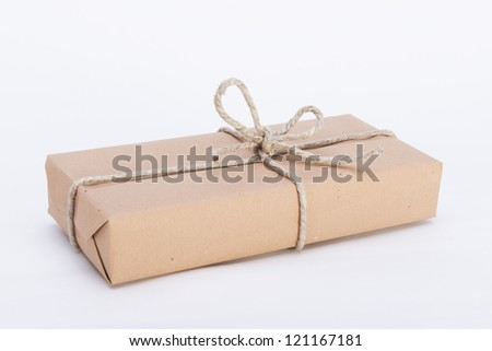 package ready for shipment, wrapped in brown paper and tied with twine