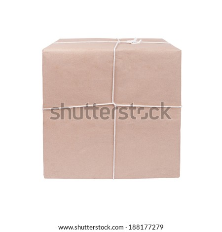 package ready for shipment, wrapped in brown paper and tied with twine - stock photo