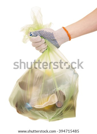 Package with household waste in woman hand isolated on white background. - stock photo