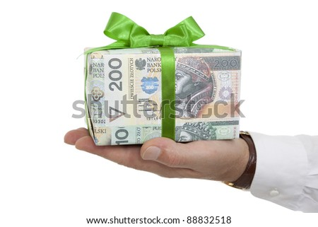 package with money and green ribbon on palm - stock photo
