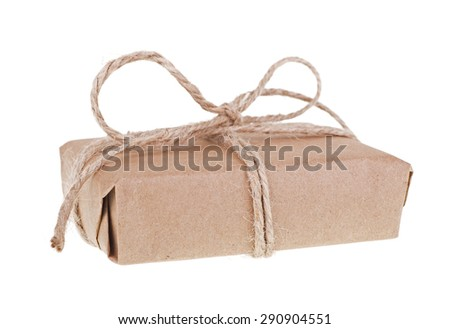 Package wrapped in brown paper and string isolated on white - stock photo