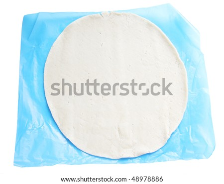 packaged uncooked pastry isolated on a white background - stock photo