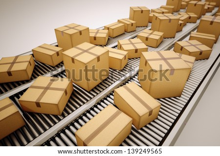 Packages are being sorted on conveyor belt. - stock photo