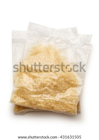 Packages of dry white rice in closeup