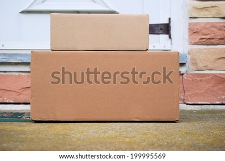 Packages on a front door step - stock photo