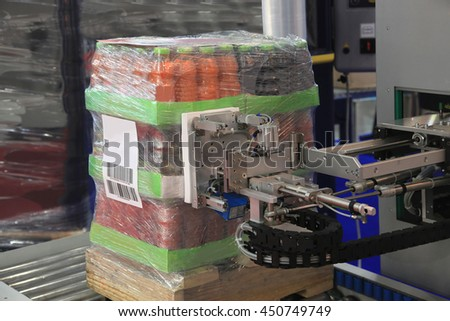 Packaging and labeling of products in stock - stock photo